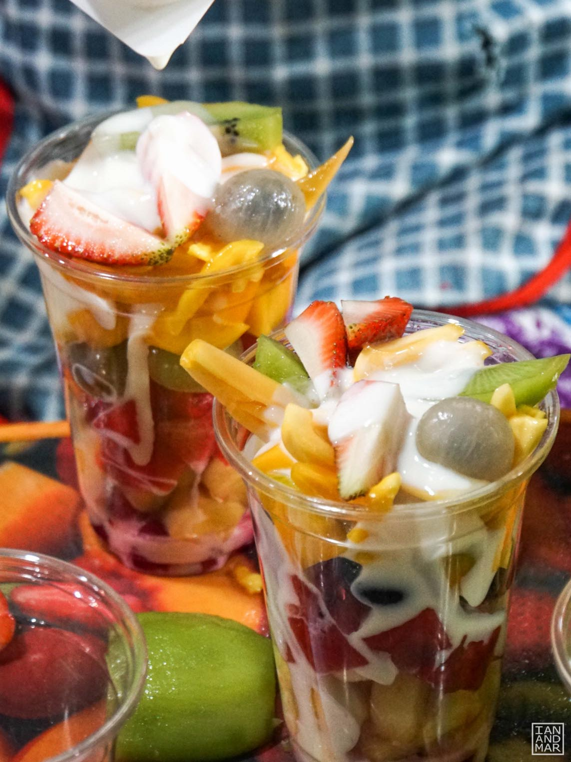 cup of fresh fruits with milk and yogurt
