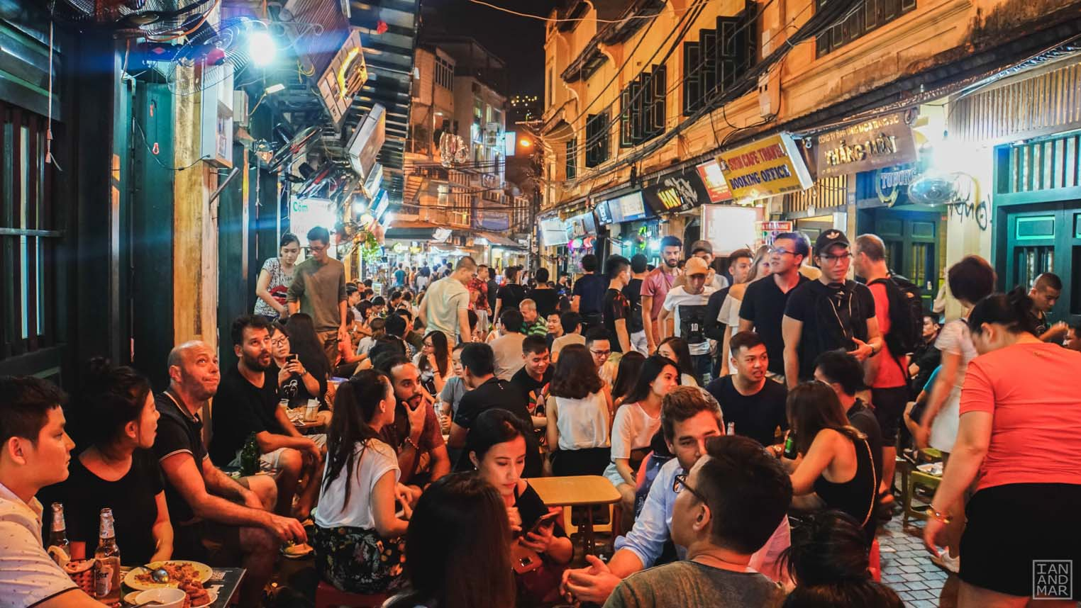 street filled with people drinking at night