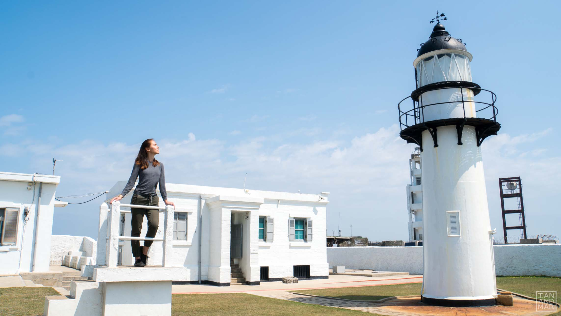 white lighthouse with girl