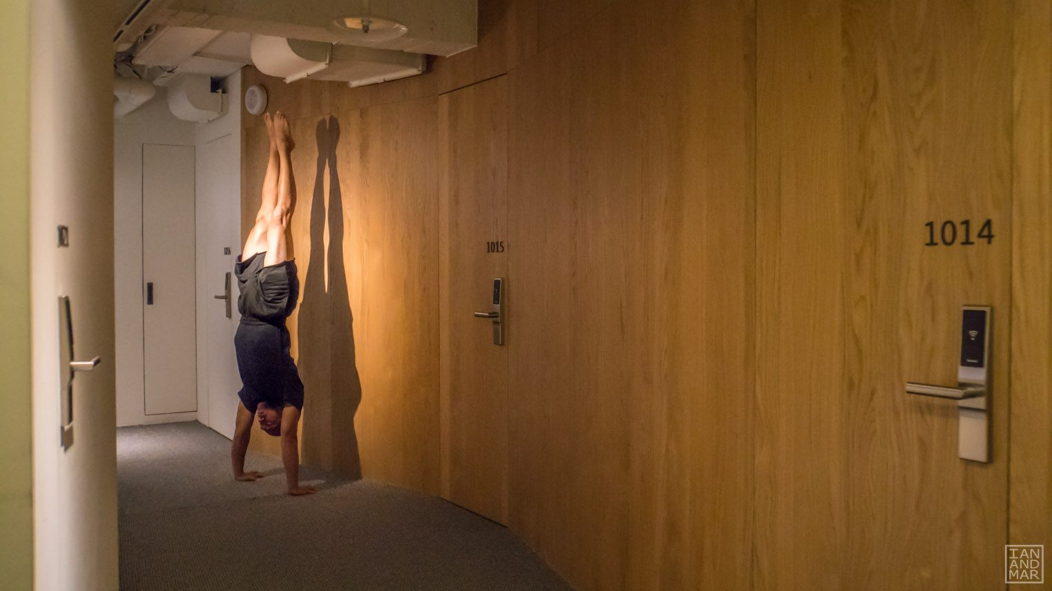 hallway with man on a handstand