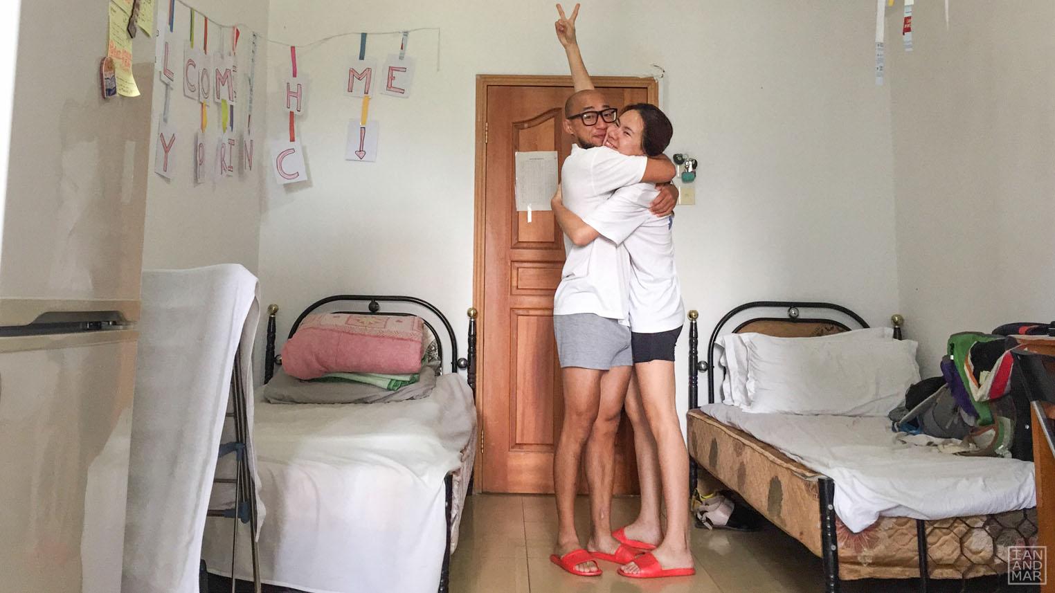 people hugging in school dorm