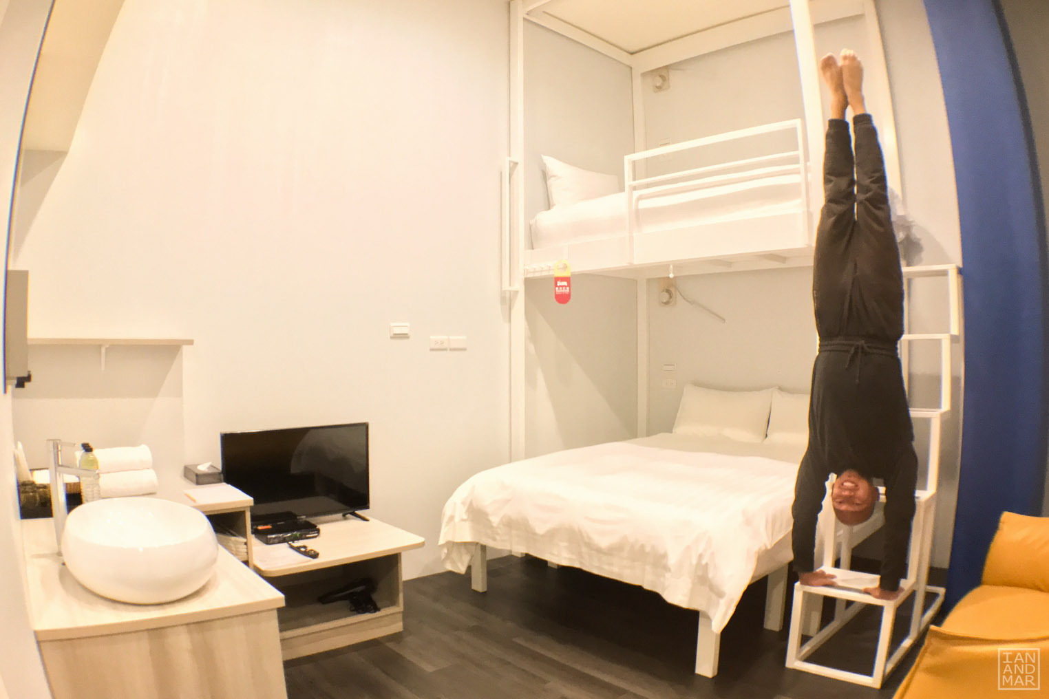 man on a hotel room doing a handstand