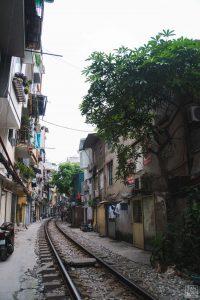 houses beside train tracks