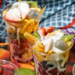 fruits and yogurt in a cup