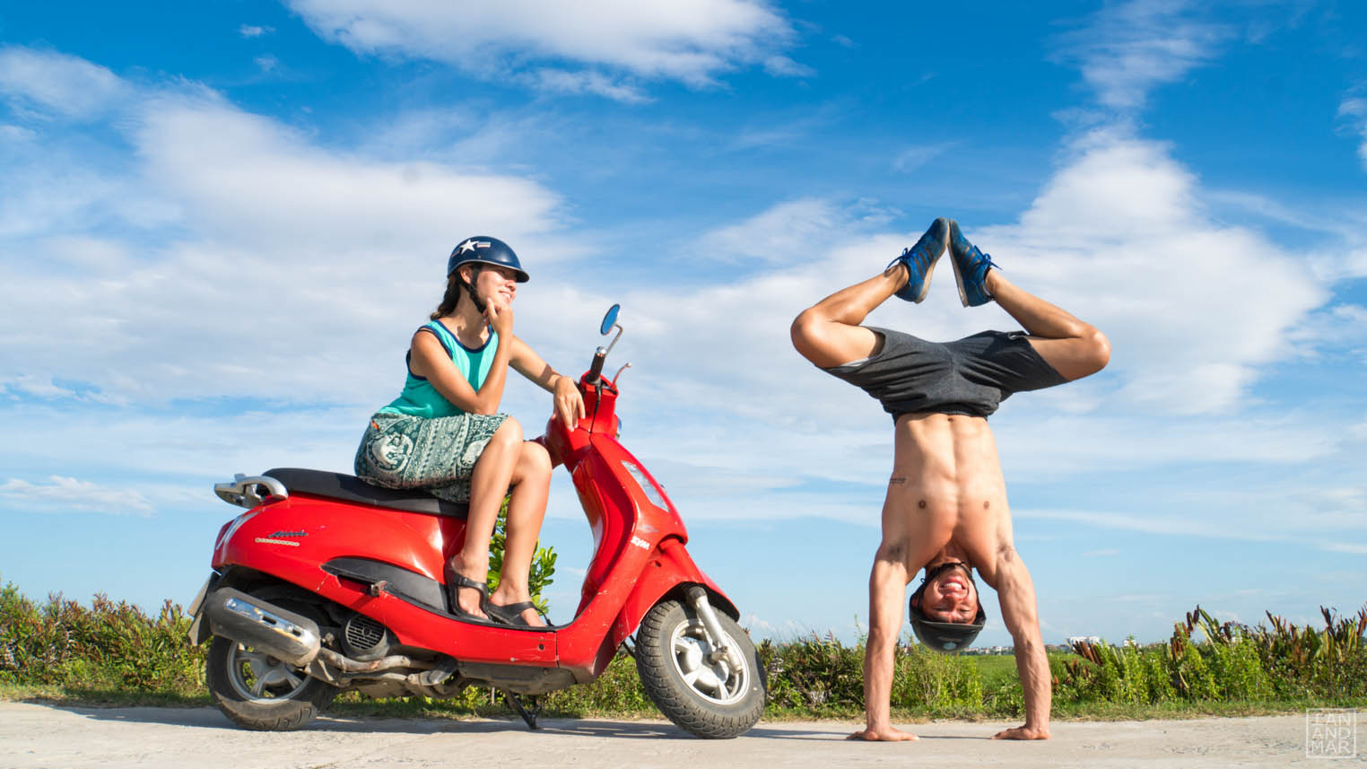 girl in scooter and boy in handstand